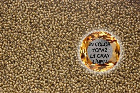 TOHO TR-11-375 In-Color Topaz/Lt Gray Lined 10g